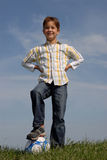 Boy with a ball. Young boy with a soccerr ball Stock Photos