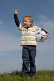 Boy with a ball. Young boy with a soccerr ball Royalty Free Stock Photos