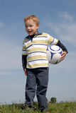 Boy with a ball. Young boy with a soccerr ball Stock Image