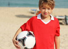 Boy with  a ball Stock Images