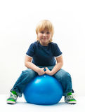 Boy on the ball Royalty Free Stock Photo