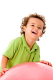 Boy With Ball. A cute young kid with a fitness ball on white background stock image