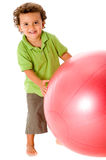 Boy With Ball. A cute young kid with a fitness ball royalty free stock images