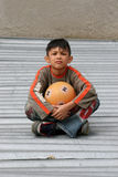 Boy with a ball. Young boy sitting and holding a ball Stock Photos