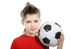 Boy with a ball. Sport theme, leisure, active life of young people. Shot in studio stock photos