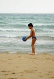 BOY BALL BEACH4. Boy playing ball on beach Royalty Free Stock Photo