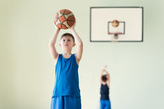 A boy with the ball. A caucasian boy in blue shirt holding backet ball Stock Photos