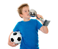 Boy with ball and cup. Jubilation blond boy with ball and cup royalty free stock photography