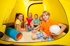 Boy with ball and friends in camping tent Royalty Free Stock Image