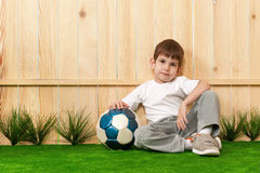 Boy with a ball in the garden Royalty Free Stock Image