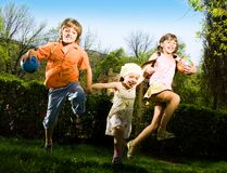 Boy with ball and girls Royalty Free Stock Photography