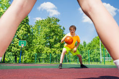 Boy with ball going to player at basketball Stock Photos