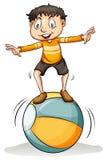 A boy on the ball Stock Photo