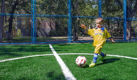 The boy with the ball. Stock Images