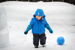Boy and a Ball Outside in the Snow Royalty Free Stock Photography