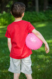 Boy with a ball in a park Royalty Free Stock Image