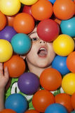 Boy in a ball pit. Carve away the marbles to expose the angel Royalty Free Stock Photos