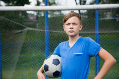 Boy with a ball playing football Royalty Free Stock Images