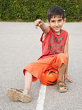 Boy with ball pointing Royalty Free Stock Images