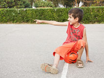 Boy with ball pointing Royalty Free Stock Photography
