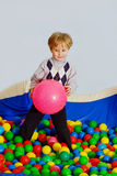 Boy in  ball pool Royalty Free Stock Images