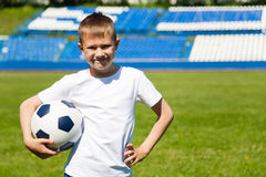 Boy with ball at the stadium. Royalty Free Stock Photography