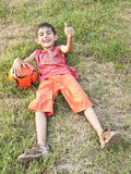 Boy with ball and thumb up Stock Photography
