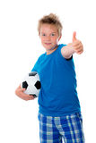 Boy with ball and thumb up Royalty Free Stock Image