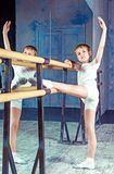 Boy ballet dancer doing exercise at dance class. Near the barre indoors royalty free stock photos