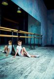 Boy ballet dancer doing exercise at dance class. Near the barre indoors stock images
