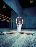 Boy ballet dancer doing exercise at dance class. Near the barre indoors stock photos