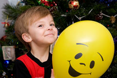 Boy and Balloon. The little boy with a yellow balloon  in Christmas night Stock Photo