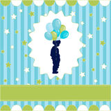 Boy with balloon, blue wallpaper Royalty Free Stock Image