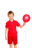 Boy and balloon Stock Image