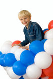 Boy and balloons. A smiling boy with balloons on white background Stock Images