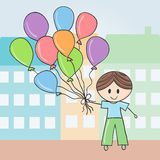 Boy with balloons in city Royalty Free Stock Image