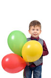 Boy with balloons. Portrait of a cute smiling little boy with balloons isolated on white background Royalty Free Stock Image