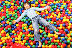 Boy on balls Royalty Free Stock Photo
