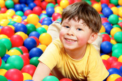 Boy in balls Stock Photo
