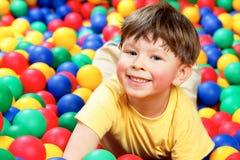 Boy in balls Stock Photo