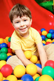 Boy in balls Stock Photography