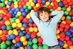 Boy on balls Stock Images