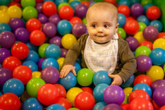 Boy among balls Stock Image