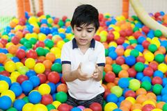 Boy in balls pool Royalty Free Stock Photos