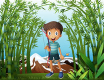 A boy at the bamboo forest with a bow and arrow Royalty Free Stock Photography