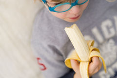 Boy with banana - child eating banana. Boy with banana - child eating fresh banana. Healthy food Royalty Free Stock Image