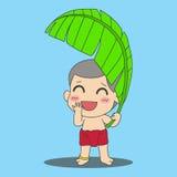 Boy with banana leaf Stock Image