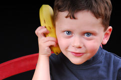 Boy on Banana Phone. Young boy acting silly with banana phone Stock Photography