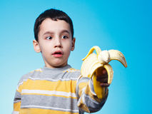 Boy with banana Stock Photography