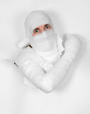 Boy in bandage put out from hole in paper Stock Photo